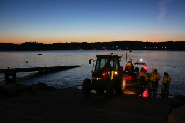 Ferryside Lifeboat being recovered from the sea at night